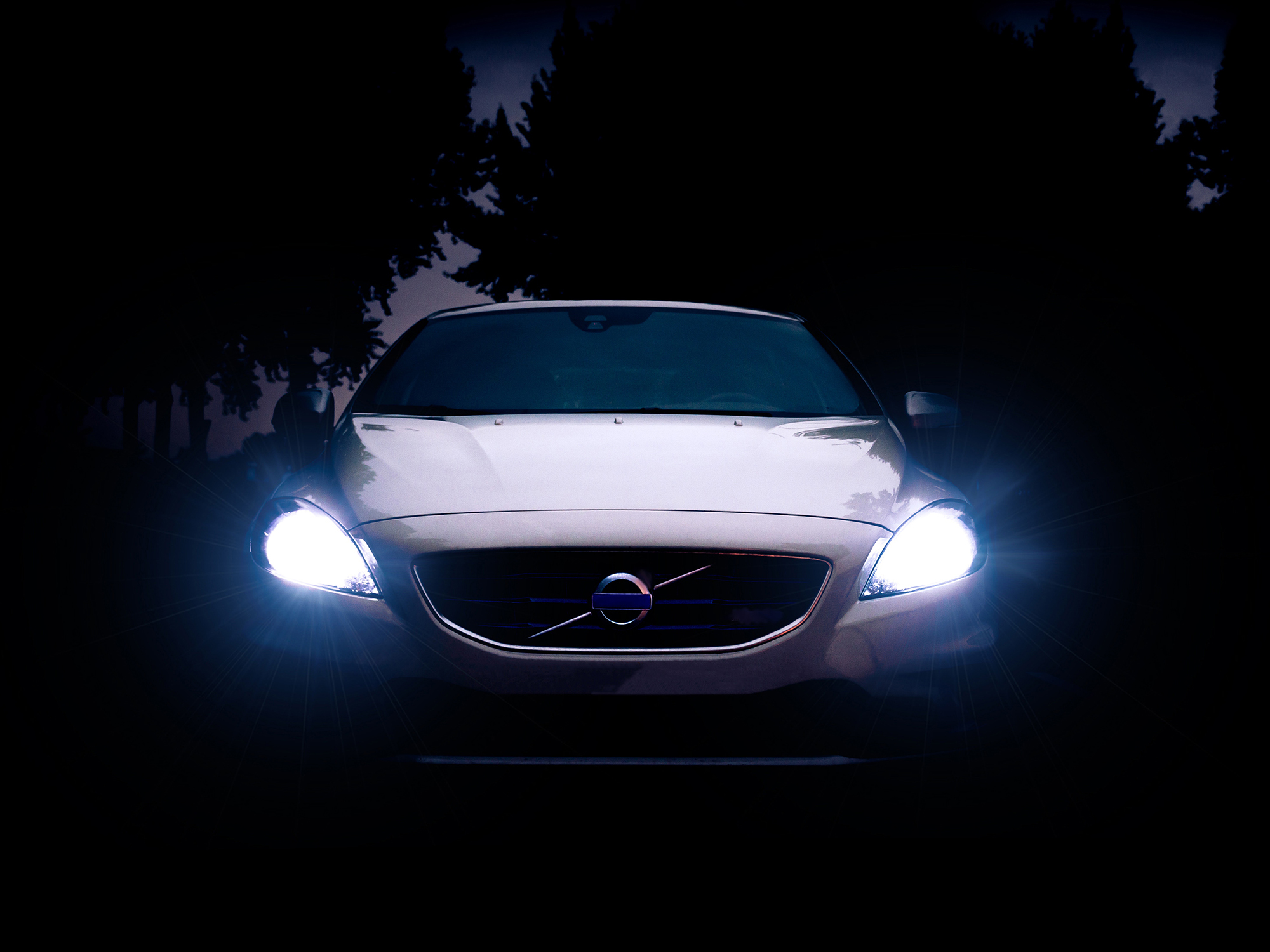 The headlights of a car in the dark.